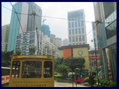 Tram passing through Causeway Bay, near the borders to Wan Chai. Causeway Bay is an urban area on the Northeast part of Hong Kong Island. It is part of both Wan Chai and Eastern districts. We only past the area by tram.