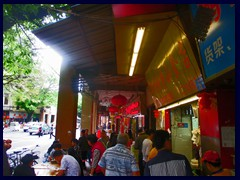 "Guangzhou Qiyi Lu (Guangzhou Qiyi Road) is a narrow, winding, road with small stores, markets, shoe stands and buildings in typical Chinese style. It is very crowded and a bit chaotic, but it is worth to visit since it gives a taste of ""the real China"". ."