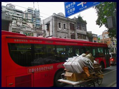 Old fashioned lorry bike and modern trolley bus, Zhongshan Road, Yuexiu district.