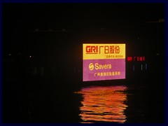 A ship with a large neon advertizement sign on Pearl River