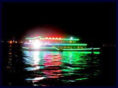 Pearl River seen from a restaurant with illuminated cruise ship.