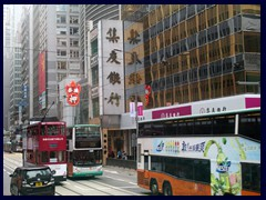 Double decked bus and trams passes along  Des Voeux Road.