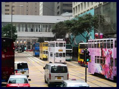 Colourful double decked trams of Central's  Des Voeux Road.