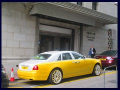 The old Bank of China Building with a strangely coloured Rolls-Royce in front.