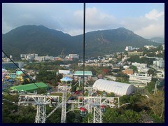 Cable cars above Ocean Park takes visitors from The Summit to The Highland on the other side of mountains.