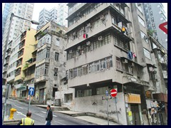 Sheung Wan is a neighbourhood that borders Central to the West. It is part of the Central and Western district. Sheung Wan is much grittier and more dirty then Central. In Sheung Wan you find tall but cheap looking apartment buildings, fine highrise hotels, stores with dried fish and dried everything you can think of, stray cats, food stores, Taiwanese stores, markets, fruit stands and cheap but generally good restaurants. The streets are very narrow and it smells fish everywhere. From Des Voeux Road you can easily take the tram to Central, in just 15 minutes. To the West of Sheung Wan is Sai Ying Pun, a smilar neighourhood. Our first hotel, Best Western, was sitauted just between the borders of these two neighbourhoods. Despite the gritty atmosphere, this area is generally very safe.