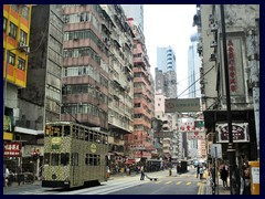 Typical double decked tram towards Central on Des Voeux Road, Sheung Wan.
