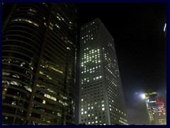 Central by night - Four Seasons Place and Jardine House with its round windows.