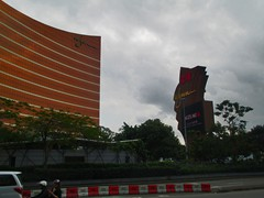 "Wynn Macau Hotel Casino. The Macau branch of this 5-star Vegas hotel offers not only casino but restaurants, a luxury shopping center, spa, and a ""Performance Lake"". It opened in 2006 and has 1014 rooms. The buildings are in bronze glass."