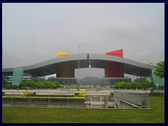 Shenzhen Civic Center or Citizen's Center is an enormous building complex, that is famous for its colourful exterior and curved roof. It opened in 2004 and was designed by John M. Y. Lee  and Michael Timchula and is one of the world's largest buildings and consists of two main halls, connected by a curved roof in the shape of a bird that can be passed underneath, after walking up through stairs. It houses the City Hall with 26 government agencies, as well as an exhibition center, a shopping mall, conference center and the interesting Shenzhen Museum. Around the complex you wil find a large park, Wongtee Plaza and Central Walk shopping malls, several large hotels, one of China's larges book stores, the Childrens Palace and the Shenzhen Library and Opera buildings. Concerts and performances are taking place in the area.