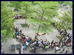 People gather on a sunday in Futian district.