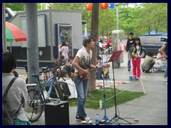 Beatles inspired pop musician performing in Futian, near Civic Center