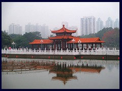 Lizhi Park (Lychee Park) with Lihu Lake.This park is situated right next to Shennan Road, Shun Hing Square and KK100. Here you find traditional Chinese architecture, like this pavilion, and views of Shenzhen's tallest buildings.