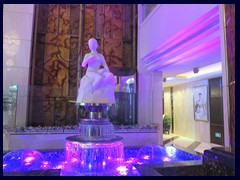 The lobby of Panglin Hotel has sculptures, fountains, marble floors and panels and glass enclosed elevators.
