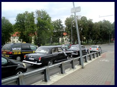 Vintage Russian wedding cars at Mindaugo bridge.
